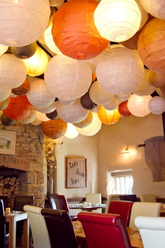 multicoloured lanterns covering the ceiling