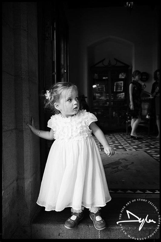 Portrait of a beautiful little flower girl in the doorway of Mount Falcon, Ballina - Photo by Dylan McBurney #mountfalcon