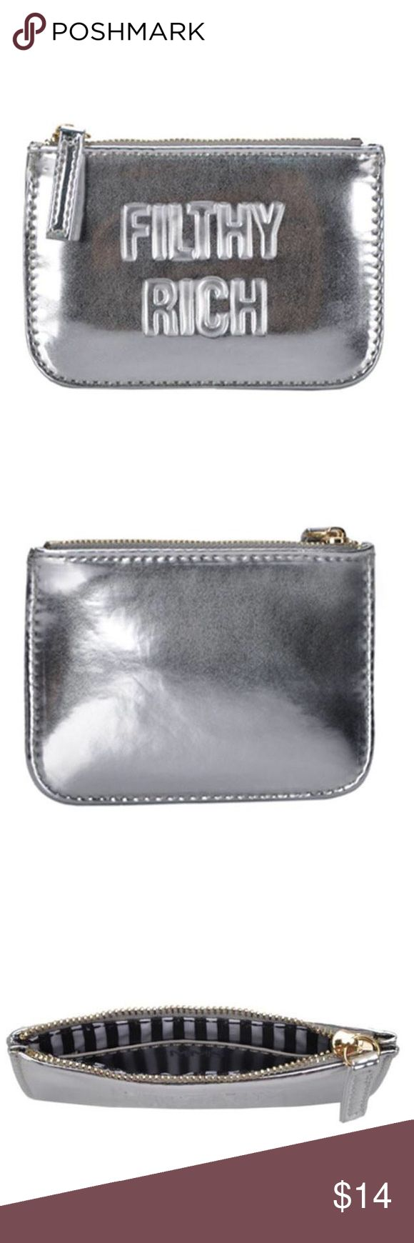 "Filthy Rich Coin Purse Stash your cash in this nifty little pouch for your next spending spree! Flat, rectangular wallet highlights a shiny metallic exterior that features ""Filthy Rich"" in stamped, capitalized typeface. Zip-top opening reveals a lined interior with an open sidewall pocket.  Length: 3.5"", Width: 5.25"", Depth: 0.5"" Man made materials MMS Design Studio Accessories"