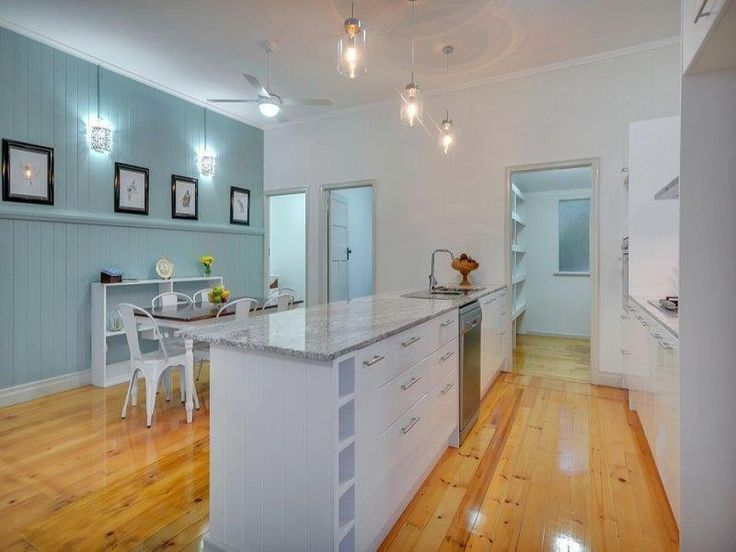 Renovated 1920's heritage listed Queenslander.    Stunning new two-pac kitchen complete with granite tops, stainless steel appliances, soft close drawers and a walk-in butlers' style pantry.