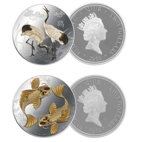 Feng Shui Cranes coin and a Feng Shui Koi coin Cranes symbolizing authority and wisdom. Koi are symbolic of unity and fidelity