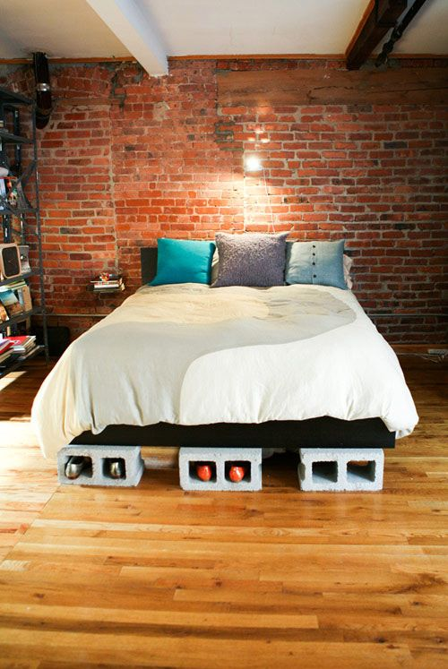 Our bed is propped up on cinder blocks (great shoe storage)