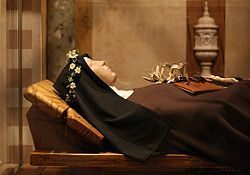 St Clare of Assisi. The incorrupt body of Saint Clare of Assisi. In 1234, the army of Frederick II took assault upon Assisi, scaled the walls of San Damiano by night spreading terror. Clare calmly rose from her sick bed, took the ciborium from the little chapel & proceeded to face the invaders at an open window against which they had already placed a ladder. As she raised the Blessed Sacrament on high, the soldiers who were about to enter the monastery fell backward as if dazzled & took…