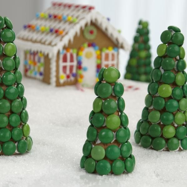 Surround your gingerbread house with sugar ice cream cones decorated with candy-coated chocolates in shades of green. Easy to make, you and the kids will have fun sticking the candy on with icing.