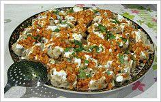 Mantu  --  (Afghani Beef Dumplings topped with Mint-Yogurt and Meat Sauce)   (see also:  http://www.sbs.com.au/food/recipe/10747/Mantoo  )