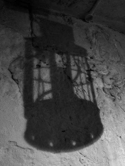 Shadow of a lamp in a York prison cell,  York Castle Museum.