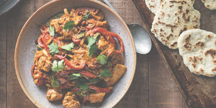 I Quit Sugar: Chicken Korma with Cumin Naan by Callum Hann     130 g Greek-style yoghurt.     3 cloves garlic, thinly sliced.     1 piece ginger, thumb-sized, finely grated.     2 c coriander, stems finely chopped, leaves reserved.     2 tsp garam masala, plus 2 teaspoons extra.     4 (100g) chicken thighs, boneless.     2 tbsp olive oil.     1 brown onion, halved and thinly sliced.     1 red pepper, thinly sliced.     2 tsp curry powder.     250 ml tomato passata    2 c spinach