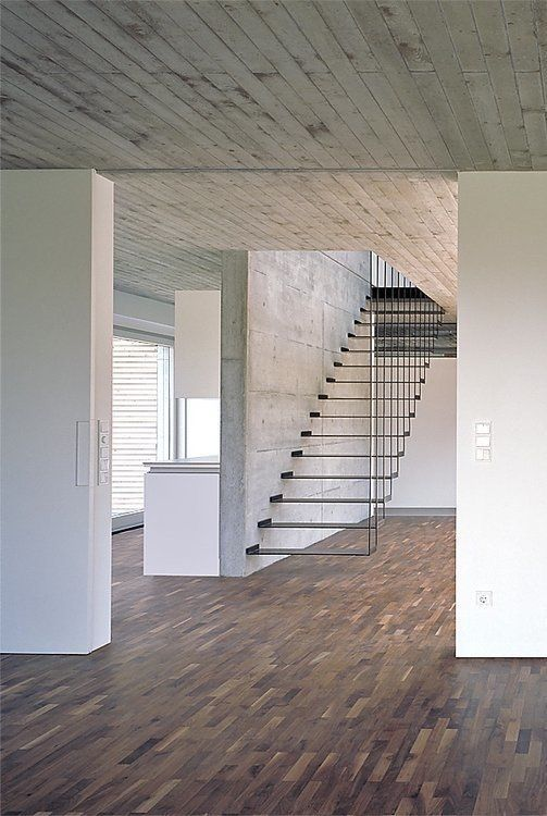 floating stairs and concrete ceiling