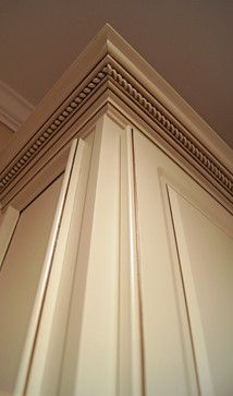 Adding crown molding with a rope trim is an excellent way to dress up and finish off upper cabinet space. Trim work provides additional beauty and gives the look of a well designed kitchen. It's little details that make a strong impact.