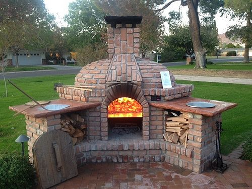 pizza oven on top fireplace below with rotating floor of pizza oven pizza oven