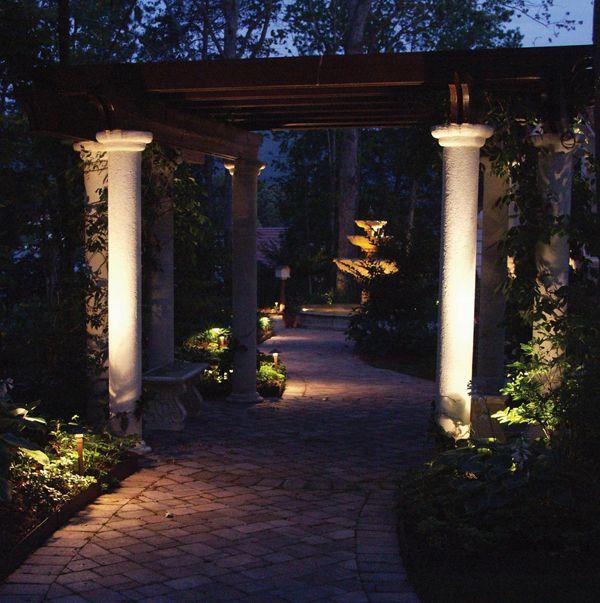 Landscape lighting at a columned portal
