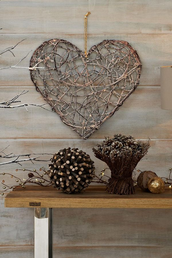 A wood inspired heart shaped craft using twigs to shape the symbol. Wires and ropes are used to hold the shape as well as the intricate and overlapping details inside the heart.