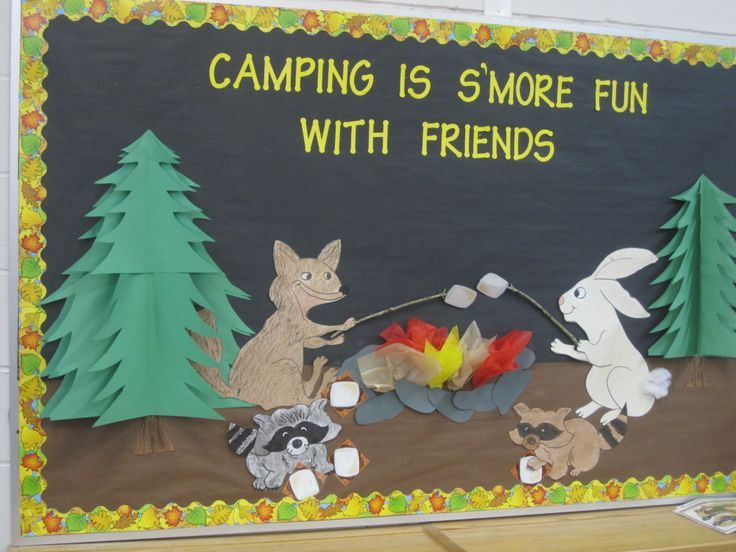 Fall camping bulletin board. I used tissue paper to make the flames for the fire. 3 dimensional trees