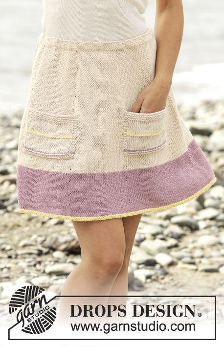 Gebreide DROPS rok in tricotst met zakken, wordt van boven naar beneden gebreid van Belle. Maat: S - XXXL. Gratis patronen van DROPS Design.