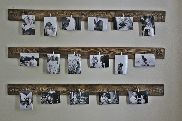 Photo display - Wood, hooks, clothes pins, string and photos.