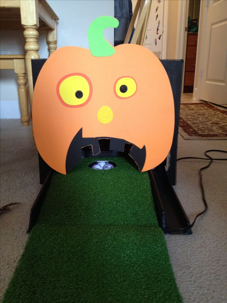 Halloween Putting Pumpkin.   Granddaughters are having a Halloween Birthday Party  so take a golf putting green, box painted black and go to Micheal's and get this foam  pumpkin and glue on front of box.  Set box over hole.  Have the ifs putt the golf ball in the pumpkins mouth.  I am using yellow golf balls.