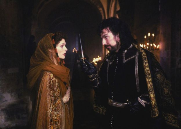 "Mary Elizabeth Mastrantonio as Marian Dubois and Alan Rickman as Sheriff of Nottingham in ""Robin Hood: Prince of Thieves"", 1991"
