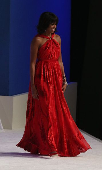 Michelle Obama Evening Dress     Michelle was a vision at the inaugural ball in this red sweeping gown.   Brand: Jason Wu  First lady Michelle Obama walks on stage during the Commander in Chief Inaugural Ball at the Walter E. Washington Convention Center on January 21, 2013 in Washington, DC. U.S. President Barack Obama was sworn in for his second term earlier in the day.