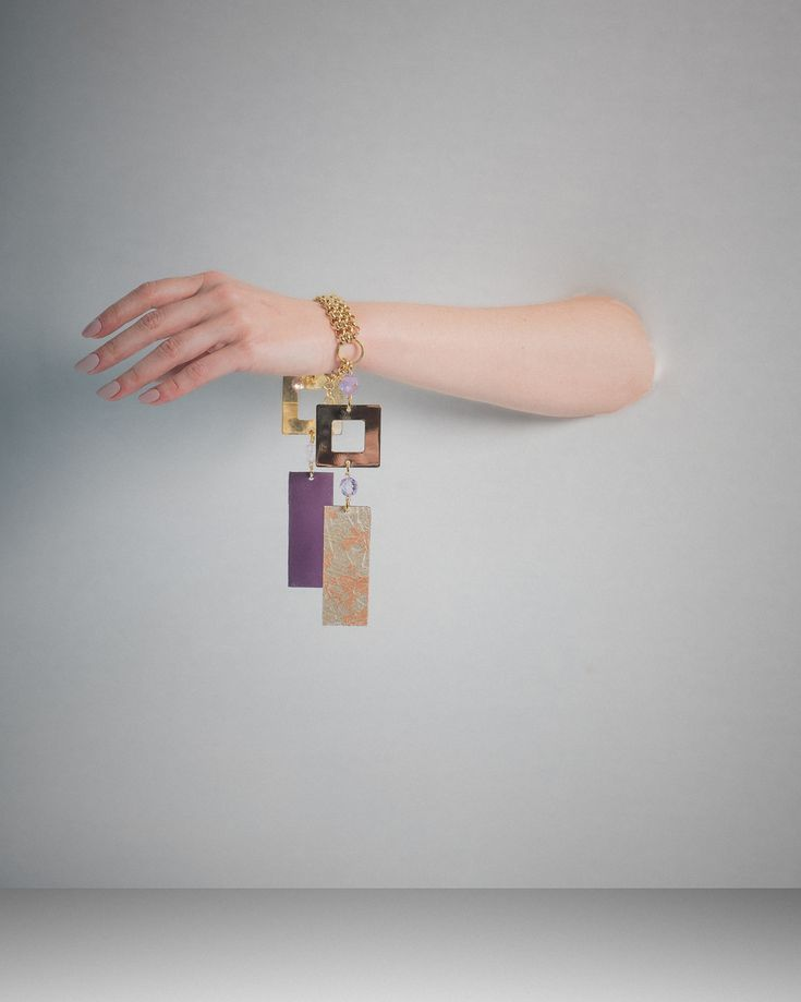 Lucille cuff can be your statement jewel, day and night! Metals covered with leather, as to get a double face jewellery!  Check it out in www.cosettejewellery.com  Photo shoot by @constantinos_lepouris  #cuffs #jewelery #handmade #leather #24kplated #gold #accessory #athens #greekdesigners #purple #golden #feminine #womenstyle #yourstyle #bedifferent #beyou #boss #brand #cosettecosette