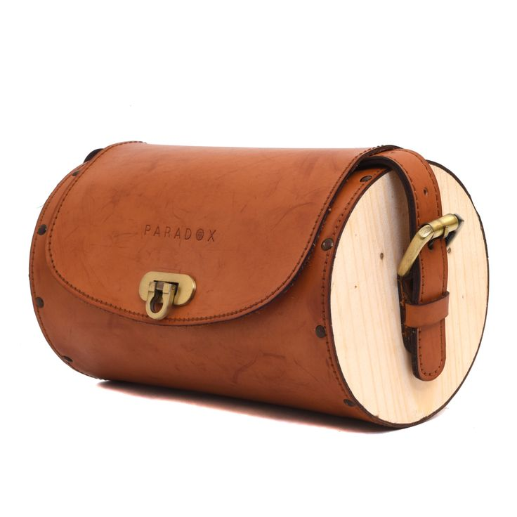 Premium handcrafted leatherite round wooden messenger bag. Beautifully handcrafted with the most premium quality material to the finest of the details. Unique round shaped sides made of imported pine wood and hand finished to perfection by our skilled artisans. exquisite combination of wood and leathrite with vintage colour scheme A must have accessory for all gender to make you stand out from the rest.