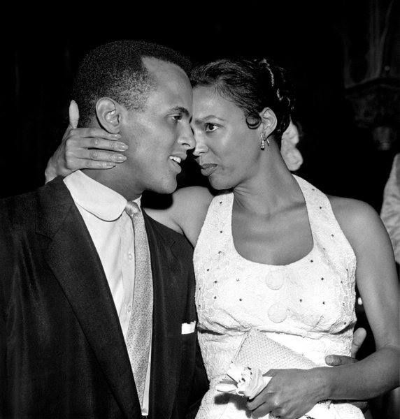 """Harry Belafonte and Dorothy Dandridge photographed by Charles Williams in an offstage moment from """"Carmen Jones"""". A very similar shot from this session appeared in the September 30, 1954 issue of Jet magazine. H/T to African Heritage City for sharing this iconic photo."""