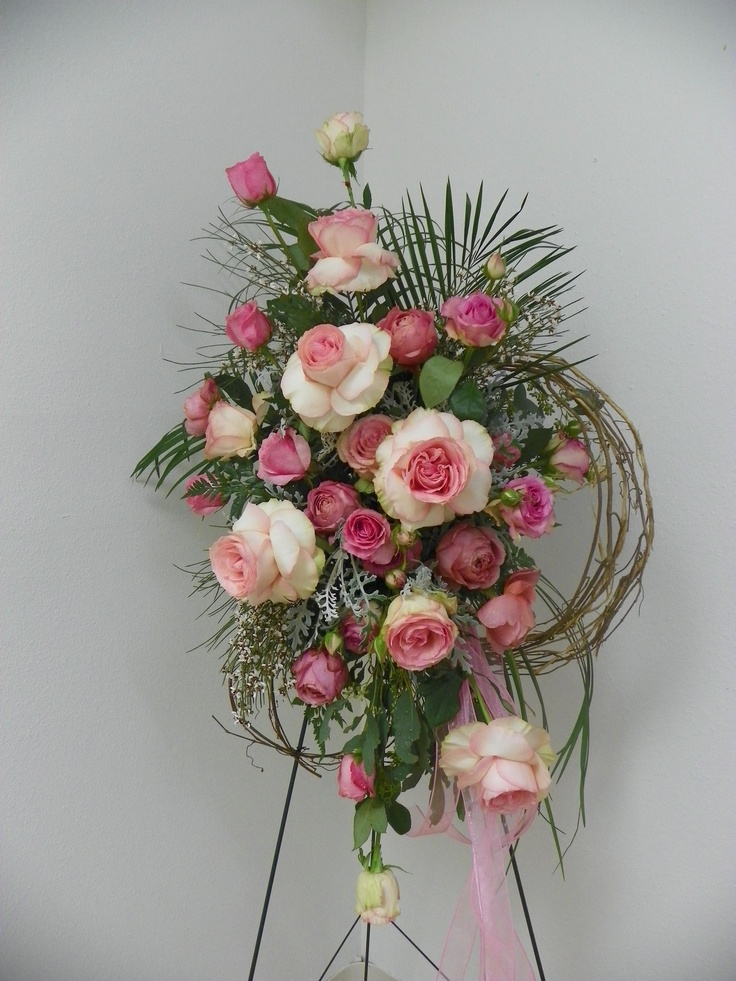 Standing Spray with roses, white ginestra, artemesia, leather leaf, roebellini palm, bear grass and bound willow.
