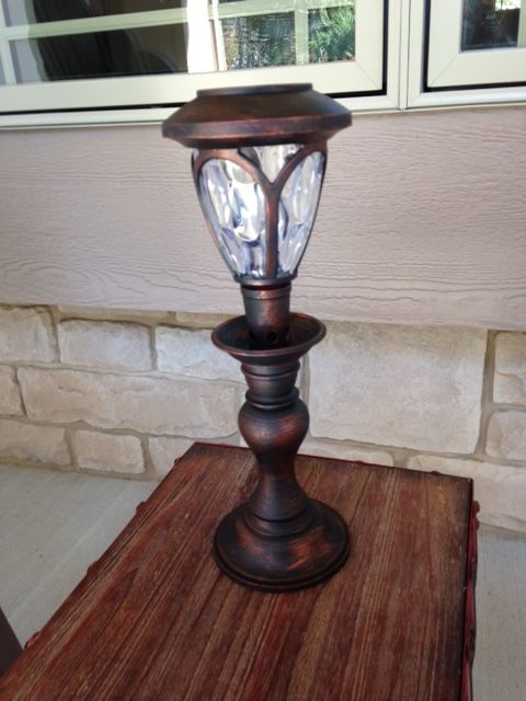 Patio/Porch solar light. Made out of old candlestick and new solar light...painted.