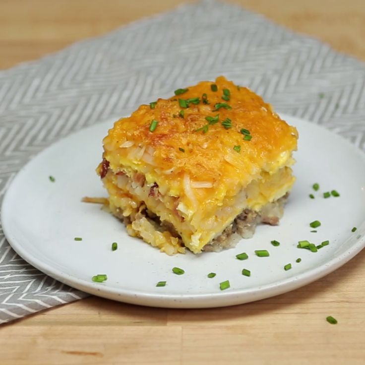 "Enjoy breakfast for dinner with this cheesy ""lasagna"" baked with hash browns, eggs, sausage and bacon."