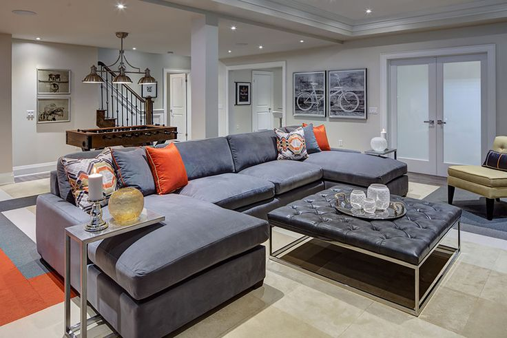Orange and gray living room with square coffee table.
