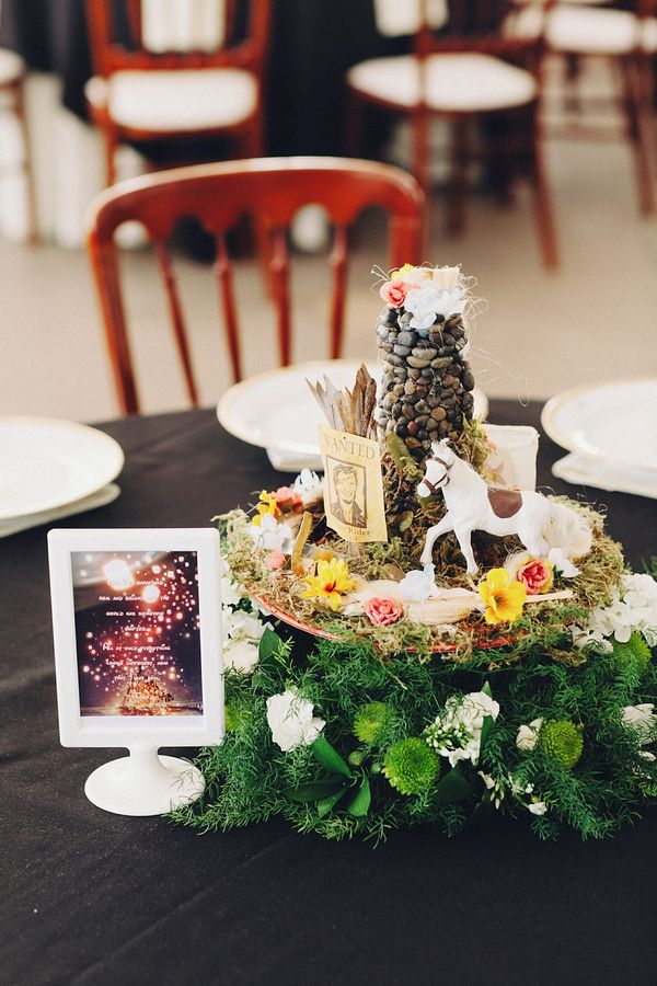 Tangled table decor - The bride and groom made amazing Disney-themed centerpieces out of their childhood toys