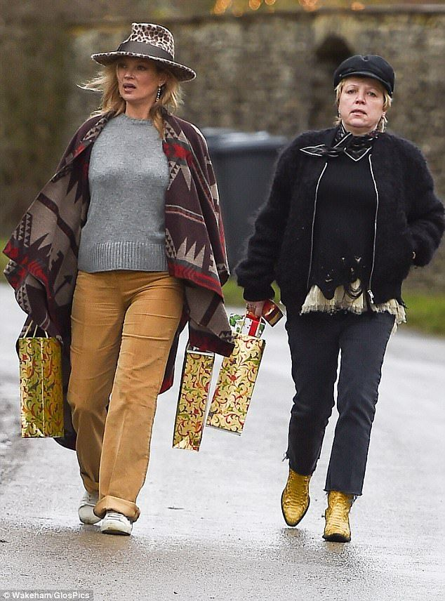 Winter warmer:The British model was typically chic in a grey knit jumper and baggy mustard jeans, layered beneath a cosy brown cape, adorned with a Navajo-inspired print