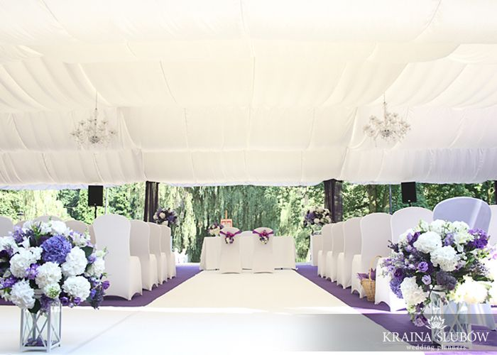 White & purple outdoor ceremony. Chic tent, chandeliers and hydrangeas...