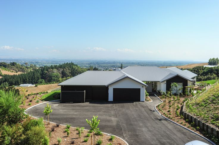 Driving up to this home, you are already in owe of the surrounding views.