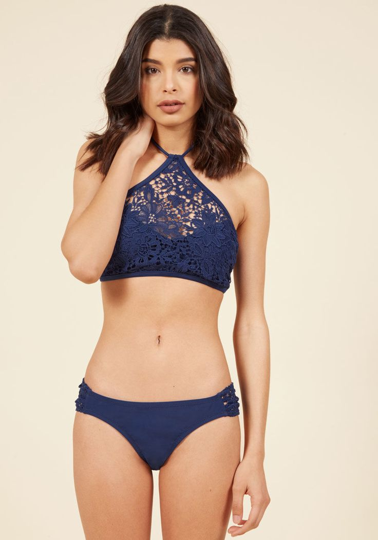 <p>Clad in these navy bikini bottoms from Jessica Simpson Swim, you indulge in the juxtaposition of luxury pool privacy overlooking the sprawling urban landscape. Rising from the water, you showcase the lace sides and low-rise cut of this stunning pair, feeling totally on top of the world!</p>