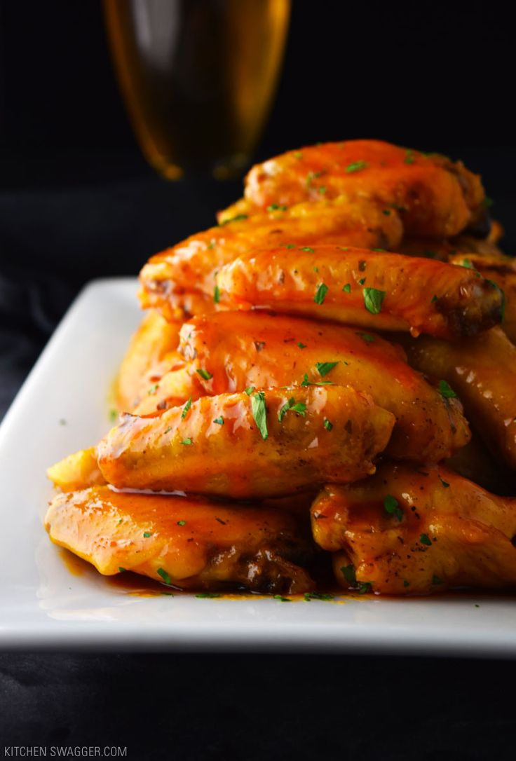 Crispy baked honey buffalo wings are slightly sweet and spicy and perfect for a crowd.