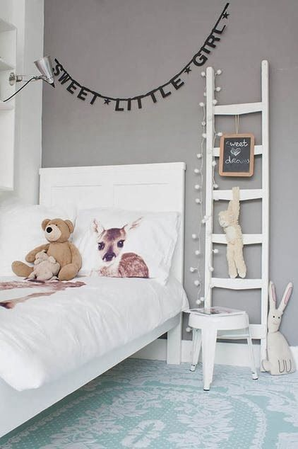 This would already match the furniture we have. Instead of a gray wall with banner, let's do a black and white wallpaper. Love the rug. Love the pillow. the boo and the boy: eclectic kids' rooms