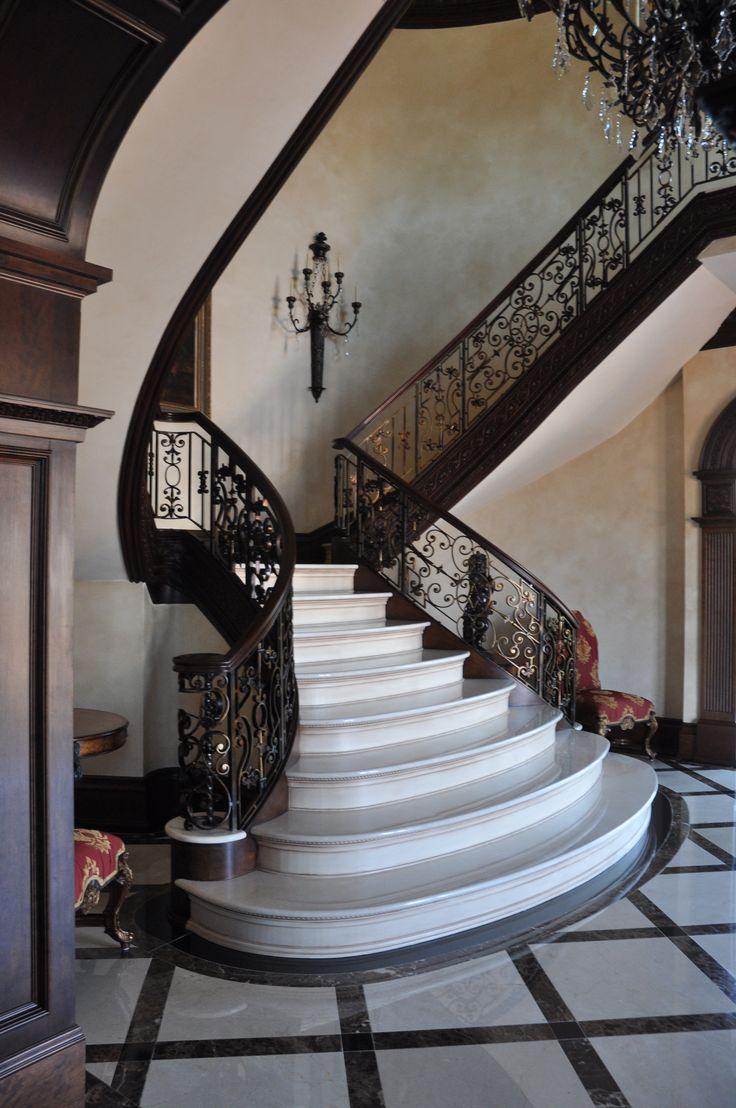 Luxury marble foyer with elegant railing design and custom ...
