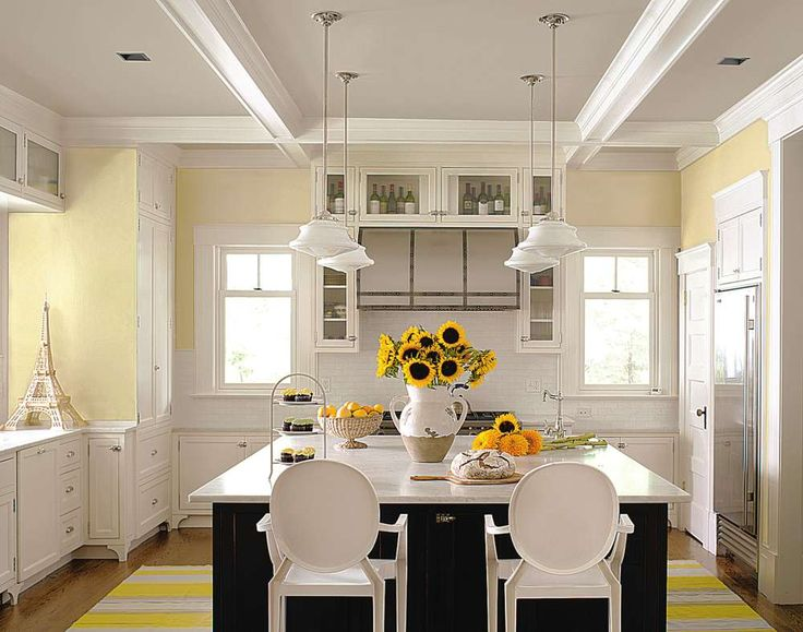 Best 25 pale yellow kitchens ideas on pinterest yellow for Blue kitchen cabinets with yellow walls