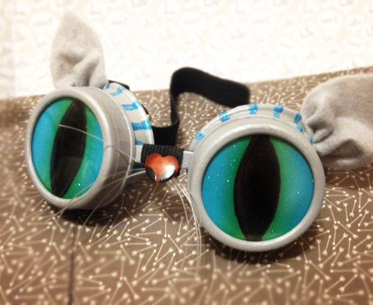 Handmade to order. Please allow adequate time to receive your goggles. I can even ship to your hotel if youre en route to Black Rock or anywhere else. FREE DOMESTIC SHIPPING! :-)  The basics: Tim Burtons color scheme gray and blue (if you want Disney colors message me first) UV lenses and hand painted cats eye lenses Removable lens caps Comfortable adjustable strap  US buyers: FREE USPS Priority Shipping No added state sales tax No import tax or duty fees (these ship from the USA)…