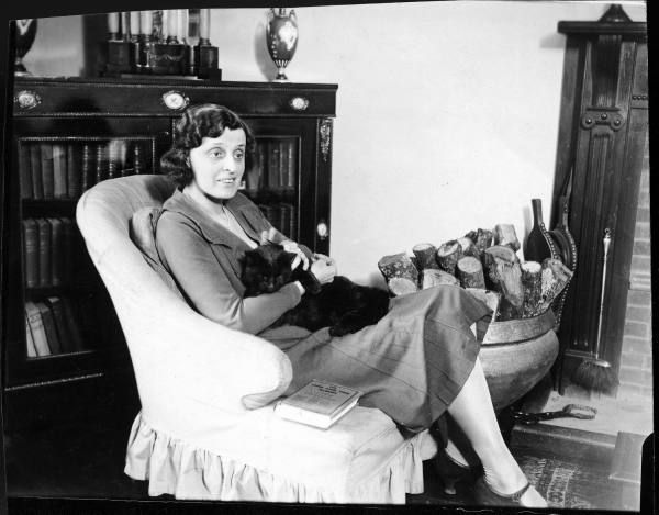 Mrs. Elizabeth M. Dashwood, aka author E.M. Delafield, with her cat at home. Location: United Kingdom Date taken: 1927
