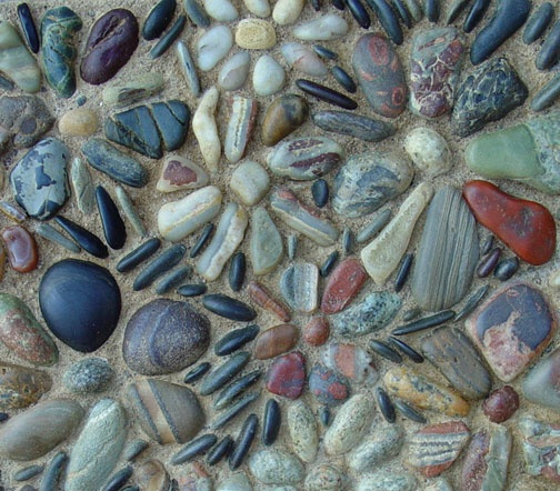 Laura Stone Flower Mosaic: These pebbles came from an unusual formation of vertical veins of quartz mixed with a variety of other minerals broken apart and tumbled smooth in the lake.