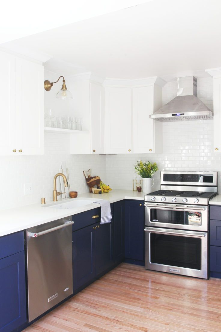 """!""""We used the basic white shaker style cabinets and then did a light sand and painted them (GS's white color is an off-white, cream tone). Countertops are from Pius – they are a white Quartz with a little bit of gray marbling.""""-the-grit-and-polish-6-day-kitchen-large"""