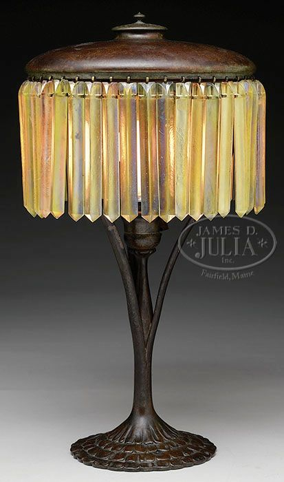 Tiffany Studio's, prism table lamp. The first Tiffany lamp was created around c.1895, during America's Gilded Age era. Beautiful in design and intricacy, each lamp was handmade by skilled craftsman, not mass or machine produced. This example was designed by Clara Driscoll, (1861-1944), who was a master designer for Louis Comfort Tiffany. ~ {cwl} ~ (image: jamesdjulia - auctions)