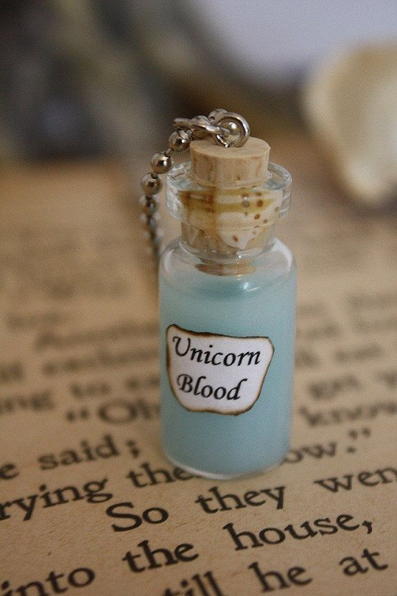 This vial reads Unicorn Blood with a silvery-blue potion inside. Comes on a 24 inch ball and chain necklace. *Please be aware that this potion must