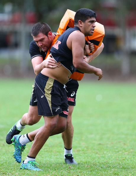 Tyrone Peachey is tackled by Tim Grant during a Penrith Panthers NRL training session at Sportingbet Stadium on March 26, 2014 in Sydney, Au...