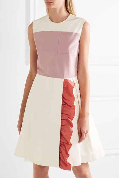 Prada's mini dress has been flawlessly crafted in Italy from lightly structured silk-faille. Cut in a flattering fit-and-flare silhouette, this ivory and baby-pink style is defined by a coral ruffle on the skirt that has a streamlining effect. Add a hint of shine with crystal-embellished pumps. Ivory, baby-pink and coral silk-faille. Concealed hook and zip fastening at back. 100% silk; lining: 60% cupro, 40% silk (Prada)