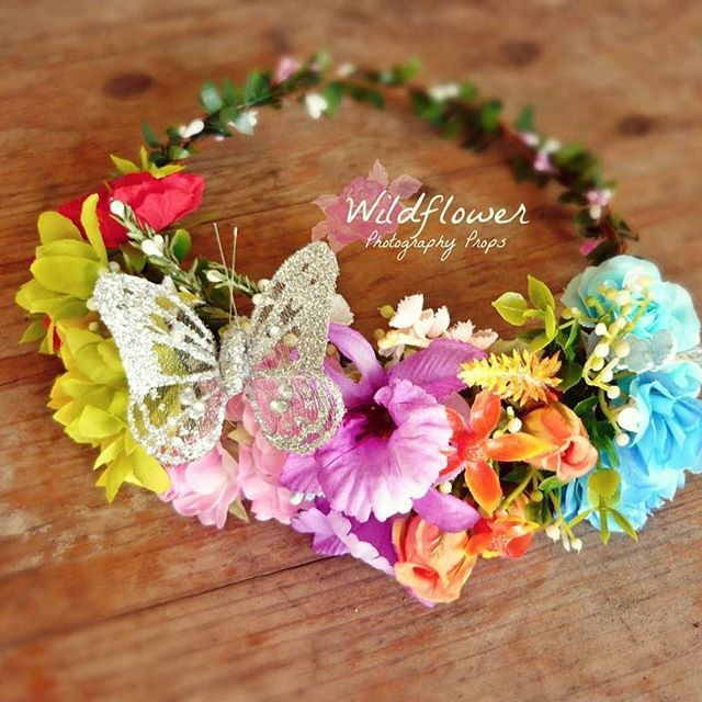A shimmering rainbow floral crown with bling butterfly of course! , what better…