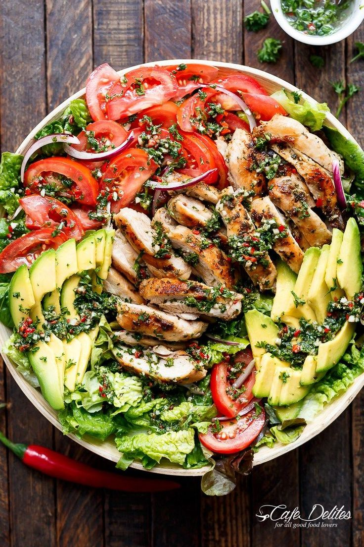 Grilled Chimichurri Chicken Avocado Salad is another meal in a salad! Using authentic chimichurri as a dressing that doubles as a marinade! | https://cafedelites.com