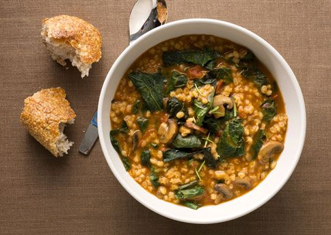 Barley Stew with Leeks, Mushrooms, and Greens: - extra virgin olive oil - chopped leeks - 8-ounce container sliced crimini (baby bella) mushrooms - garlic cloves, pressed - minced fresh rosemary - 14.5-ounce can diced tomatoes in juice - pearl barley - vegetable broth - kale