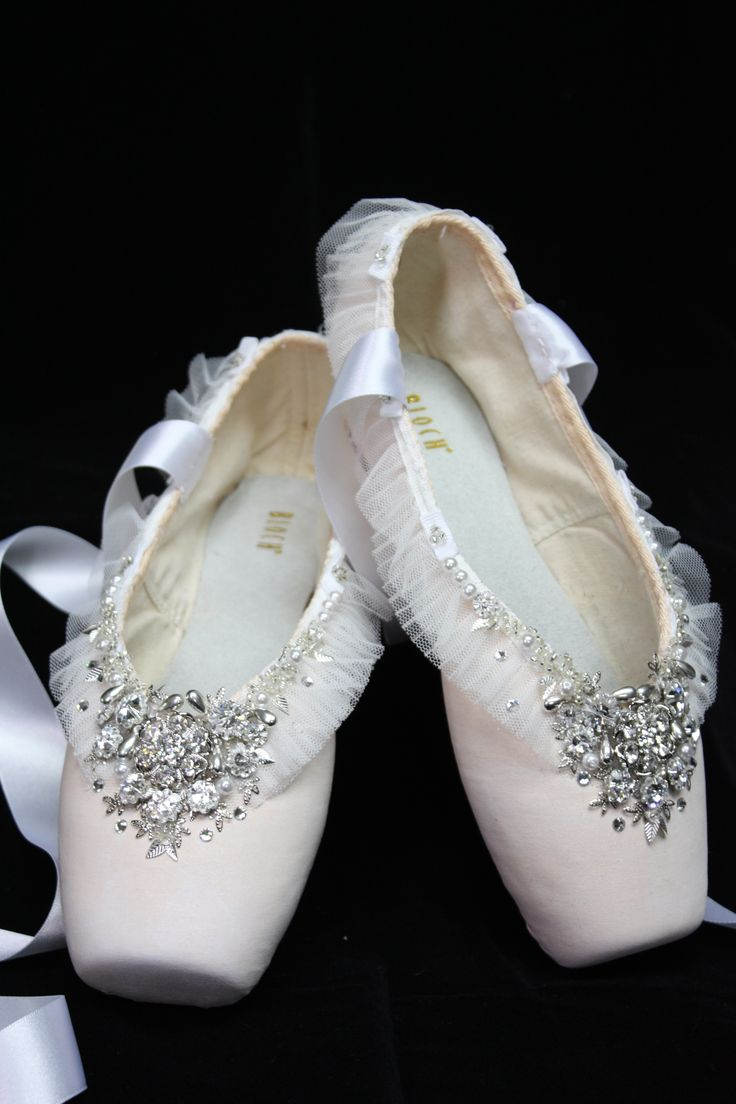 a beautiful pair of Bloch pointe shoes that I decorated in Swarovski crystals and donated for a charity auction.